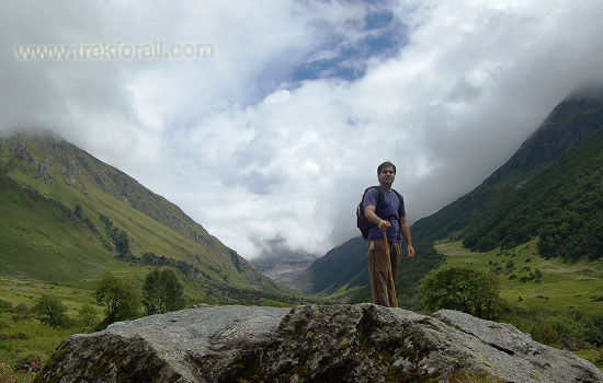 Standing on a rock to have a nice 360 degree view of Valley of Flowers