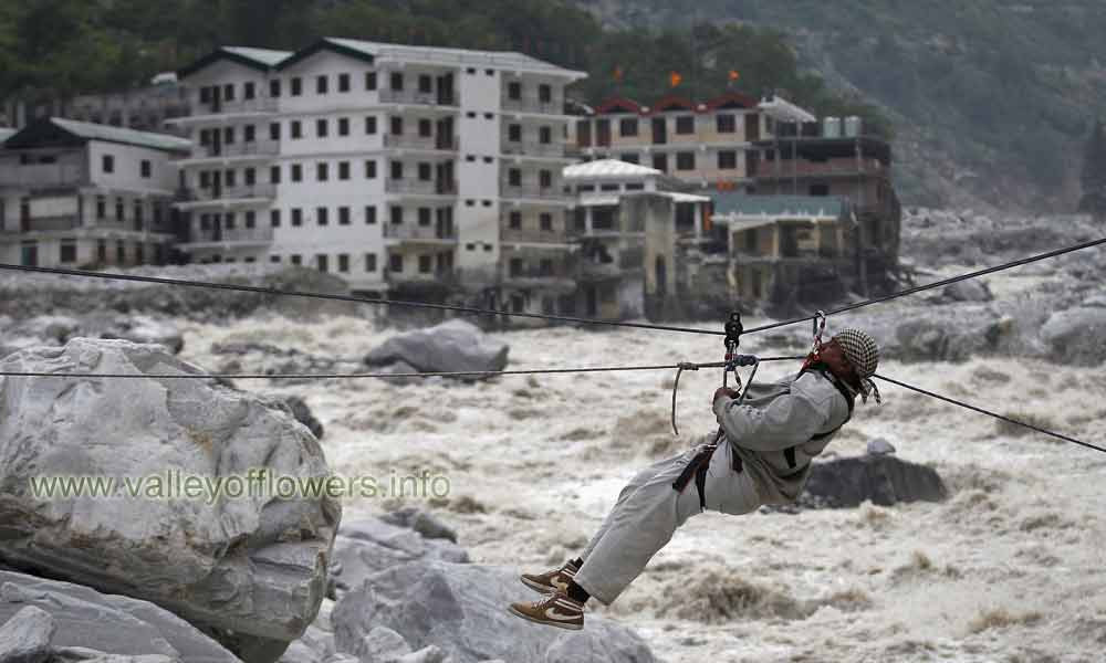 Govindghat after the floods and a man crossing Alaknanda river by rope. Just another angle, This is how some people crossed River Alaknanda.