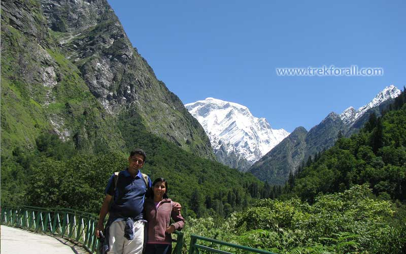 Near Bhyuandar Village, me and my wife. In the background you can see Hathi Parvat.