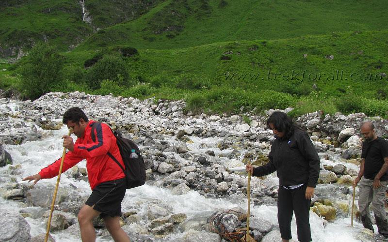 Group members crossing the streams deep inside the Valley of Flowers.