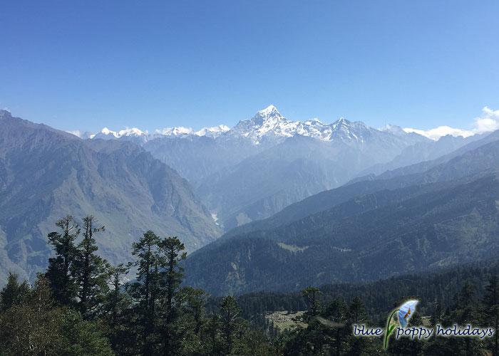 Donagiri Peak and cascading hills, view before reaching Tali